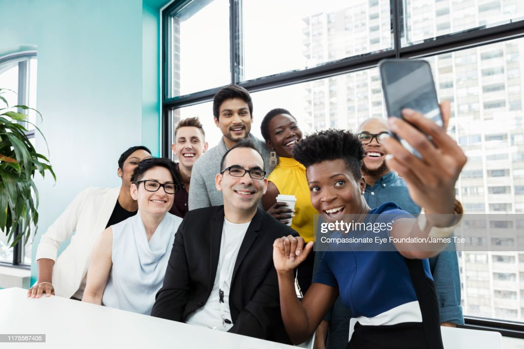Business people taking selfie in modern office : Stock Photo