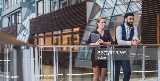 business people talking about next meeting. - businesswear stock pictures, royalty-free photos & images