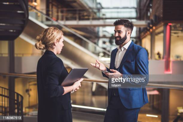 business people talking about solution. - businesswear stock pictures, royalty-free photos & images