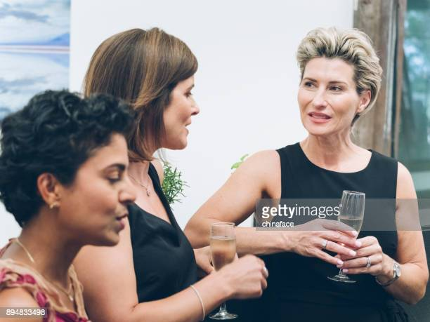 business people talking and drinking at bar