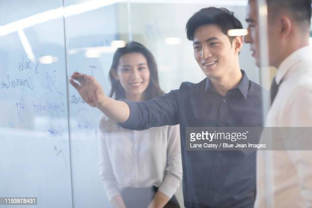 business people talking at a meeting in office - 外れる ストックフォトと画像