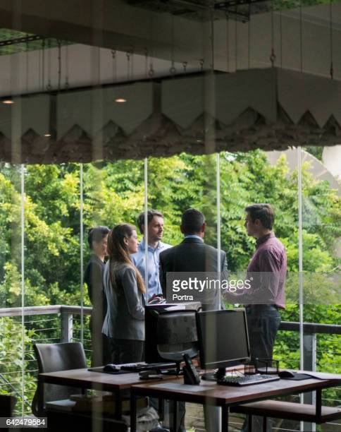 Business people talking at office balcony