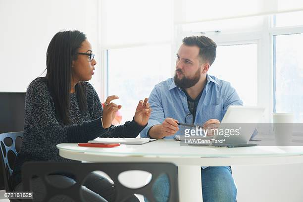 Business people talking at table