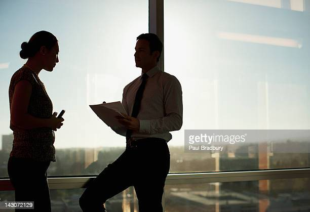 Business people talking at window