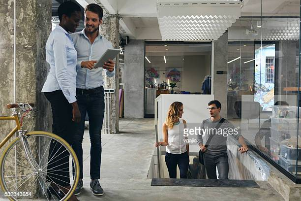 Business People Talking In A Office Corridor.