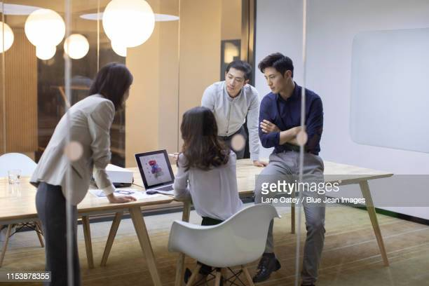 business people talking in board room - visual china group stock pictures, royalty-free photos & images