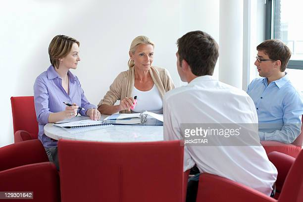 business people talking in conference - 30 39 years stock pictures, royalty-free photos & images