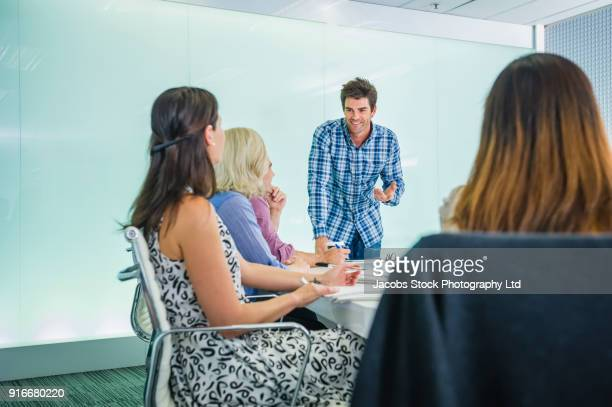 Business people talking in conference room
