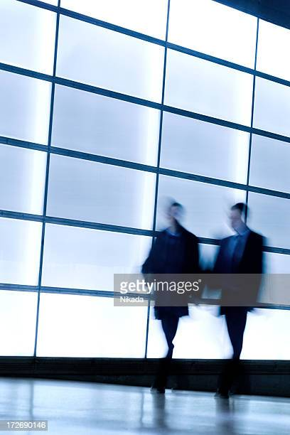 Business people talking in front of windows
