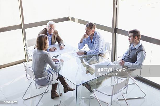 business people talking in meeting - four people stock pictures, royalty-free photos & images