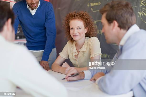 business people talking in meeting - middelste deel stockfoto's en -beelden