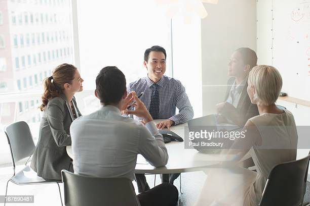 business people talking in meeting - three quarter front view stock pictures, royalty-free photos & images