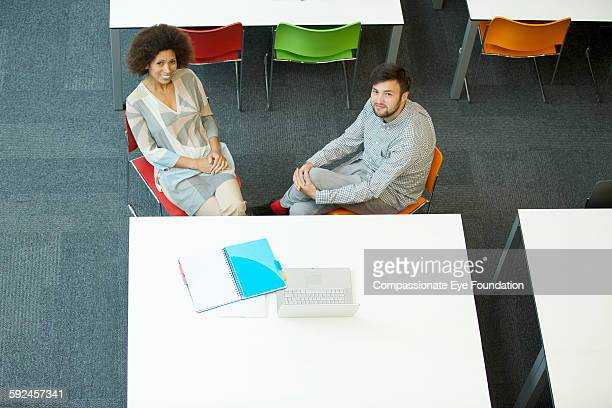 business people talking in meeting - vanguardians stock pictures, royalty-free photos & images