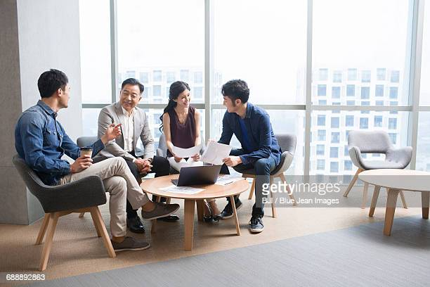 Business people talking in meeting with a laptop