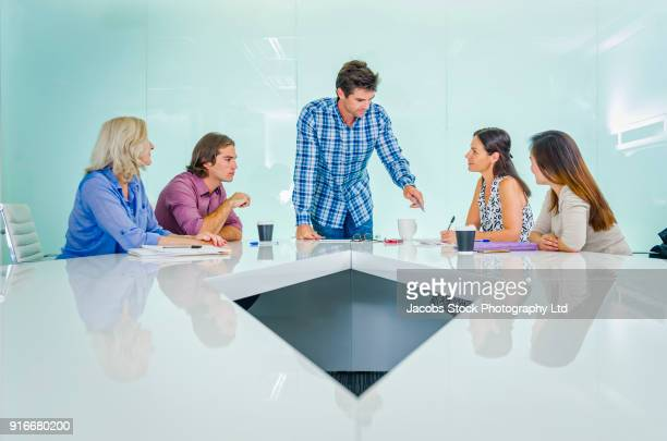 Business people talking in modern conference room