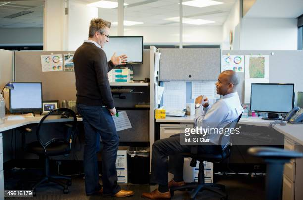 business people talking in office cubicle - office cubicle stock pictures, royalty-free photos & images