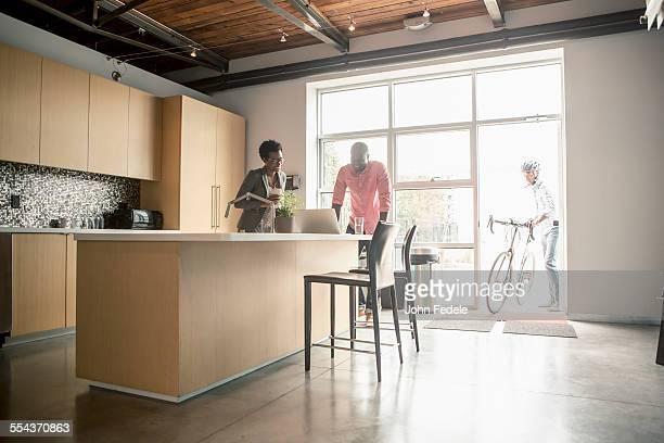 Business people talking in office kitchen