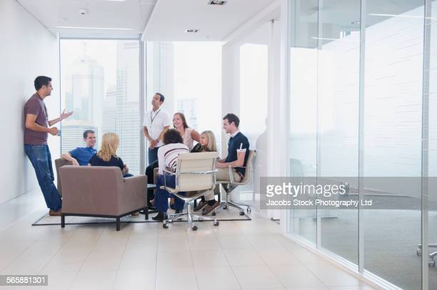 Business people talking in office lounge