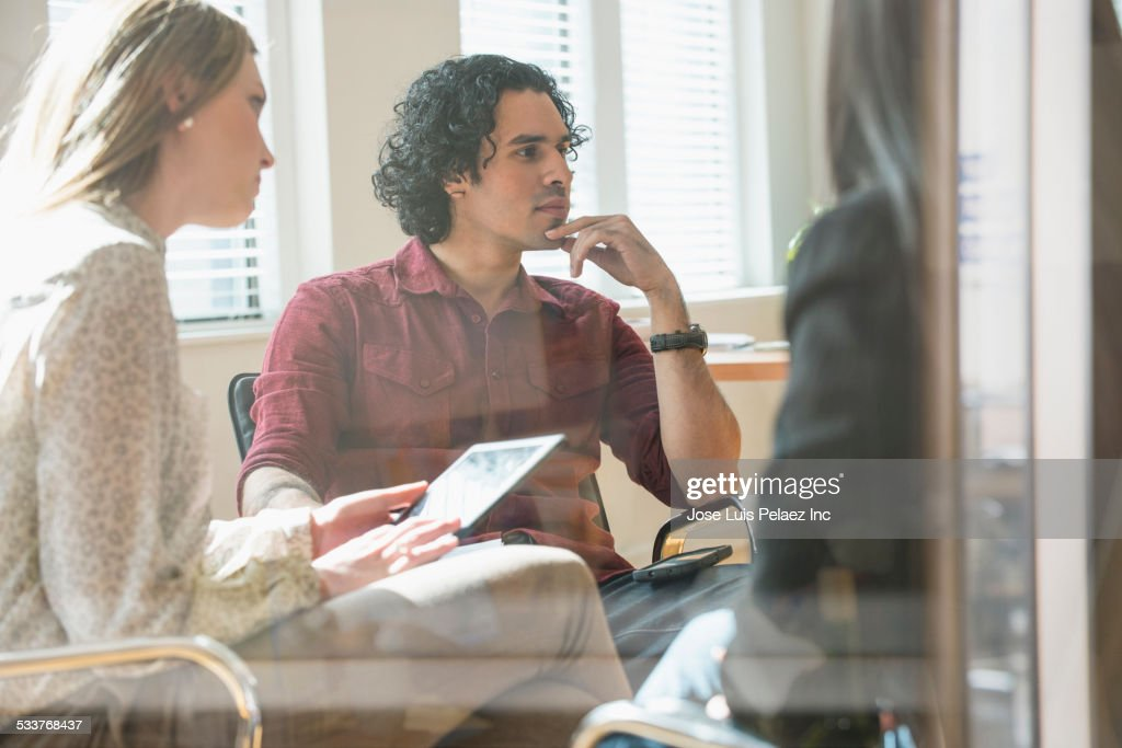 Business people talking in office meeting : Foto stock