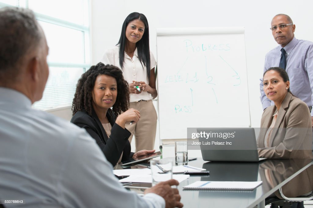 Business people talking in office meeting : Foto stock