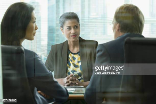Business people talking in office meeting