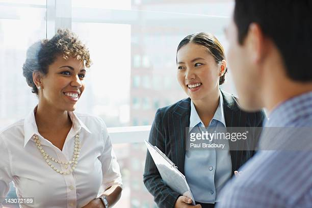 business people talking in office - three people stock pictures, royalty-free photos & images