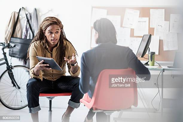 business people talking in office - multiculturalism stock pictures, royalty-free photos & images