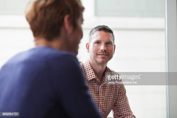 business people talking in office - jetta productions stock pictures, royalty-free photos & images