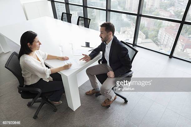 business people talking in office - performance stock pictures, royalty-free photos & images