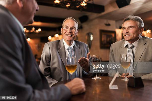 Business people talking in the bar.