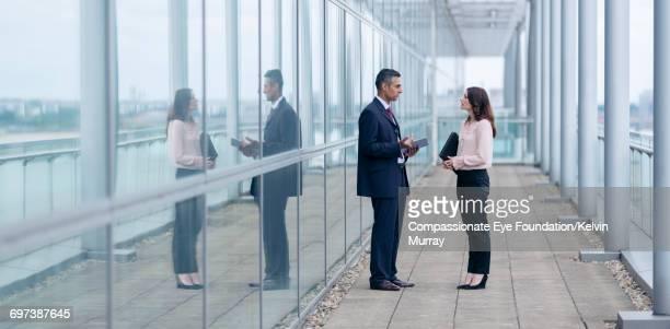 Business people talking on balcony