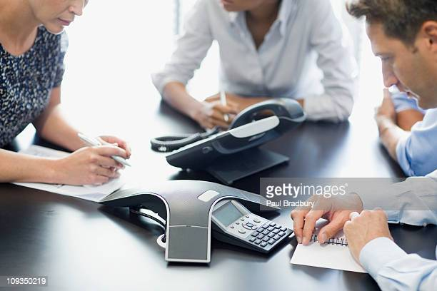 business people talking on conference call - telecommunications equipment stock pictures, royalty-free photos & images