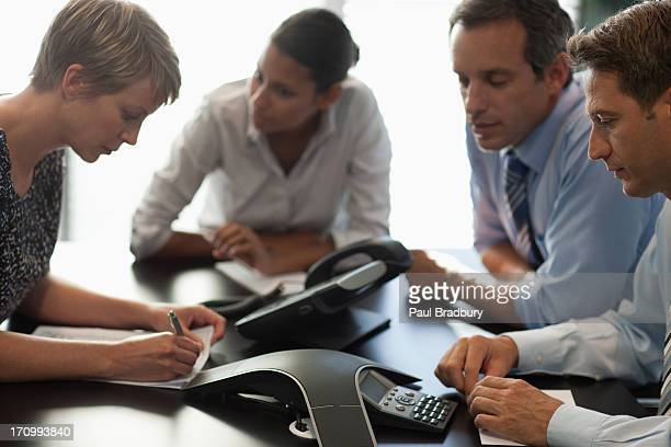 Business people talking on conference call