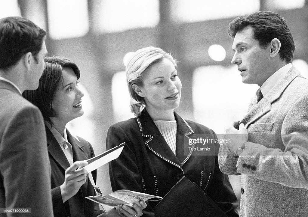 Business People Talking One Holding Ticket Bw Stock Photo