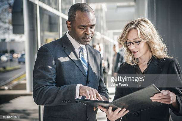 business people talking outside office building - formal businesswear stock pictures, royalty-free photos & images