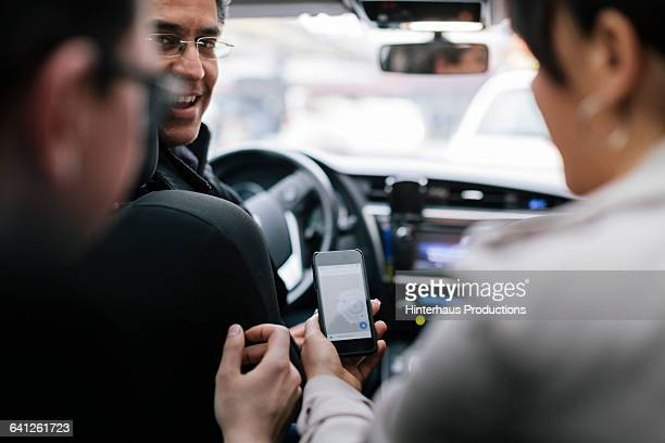 Business people talking to Taxi Driver