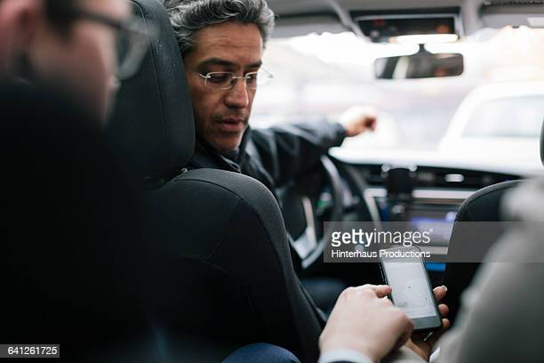 business people talking to taxi driver - taxi driver stock pictures, royalty-free photos & images