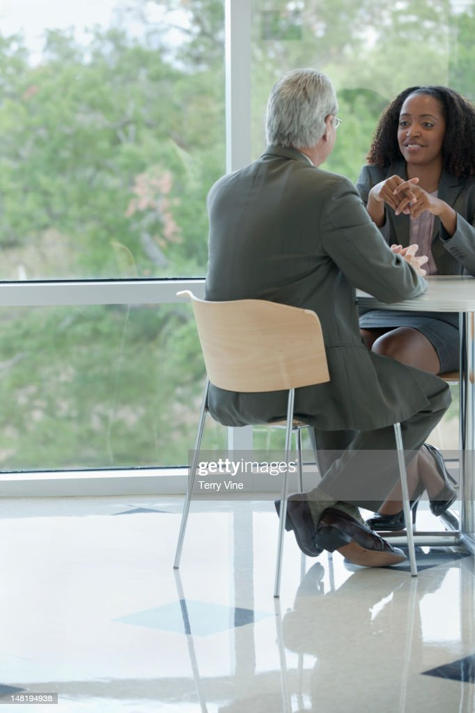 Business people talking together in cafe : Stock Photo