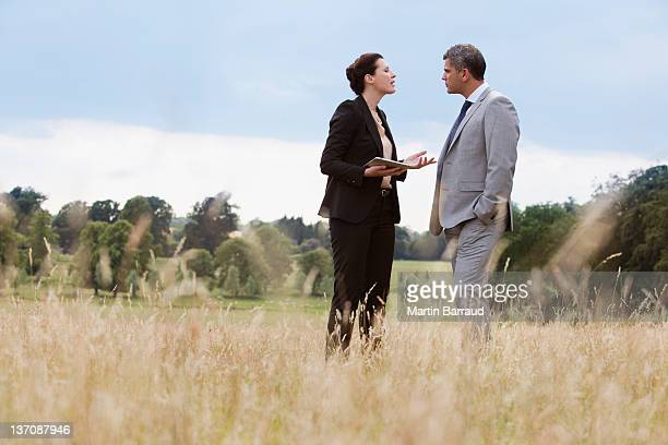 business people talking together outdoors - confrontation stock pictures, royalty-free photos & images