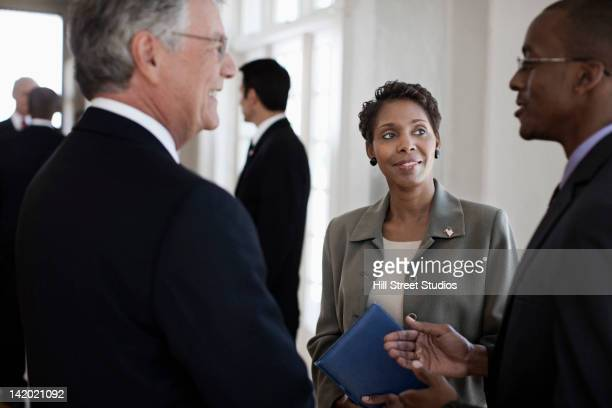 business people talking together - politician stock pictures, royalty-free photos & images