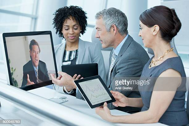 Business people teleconferencing in office
