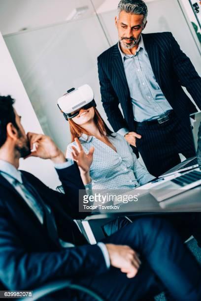 Business people testing VR simulator