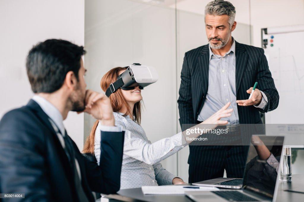 Business people testing VR simulator : Stock Photo
