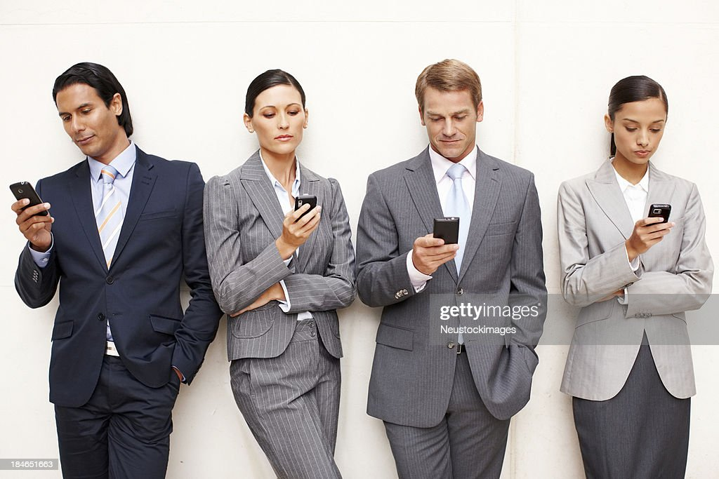 Business People Texting On Cellphones Stock Photo