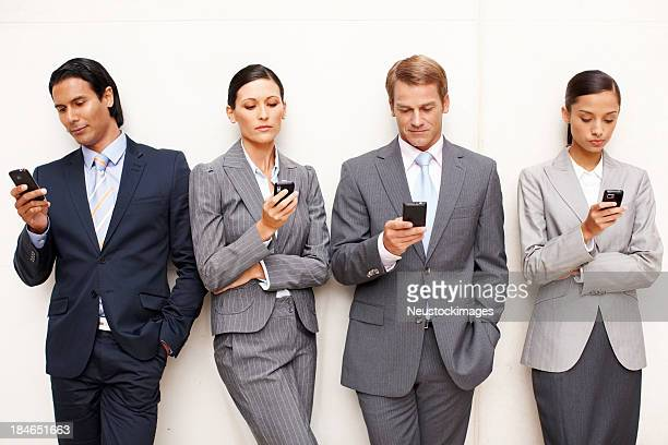 Business People Texting on Cellphones