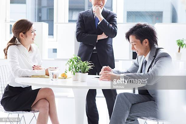 Business people that brainstorm ideas during the meeting