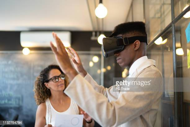 business people thinking about ideas using virtual reality simulator - cyberspace stock pictures, royalty-free photos & images