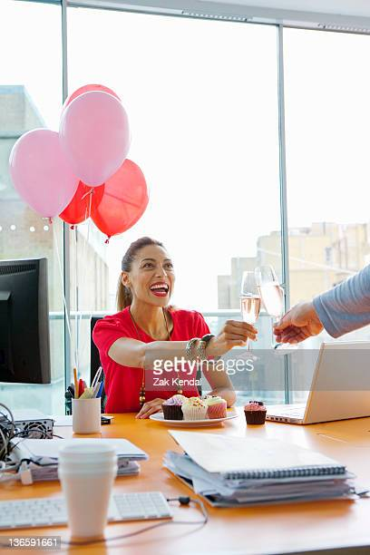 Business people toasting at office party