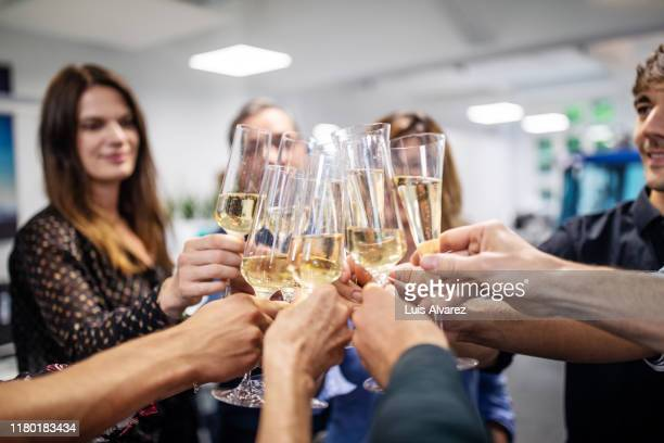 business people toasting champagne flutes in office - honour stock pictures, royalty-free photos & images
