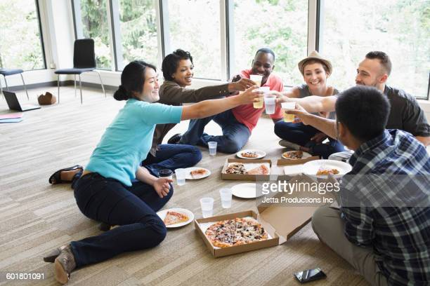 Business people toasting in empty office
